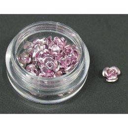 Decori per unghie in metallo a forma di rosellina. Colore rosa.