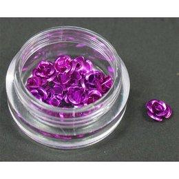 Decori per unghie in metallo a forma di rosellina. Colore viola.