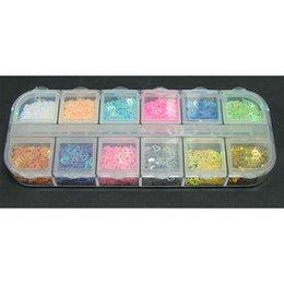 Decori per unghie cuori forati 12 colori