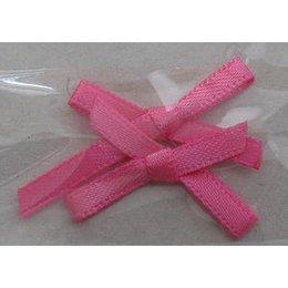 Decoro fiocco sottile di stoffa rosa