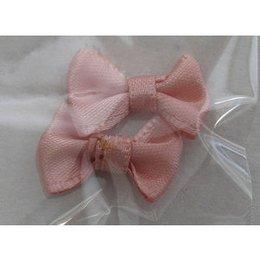 Decoro papillon di stoffa rosa